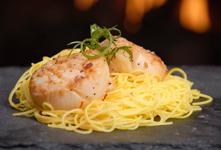 Pan-seared Diver Scallops with Garlic and White Wine on Nested Saffron Rice Noodles