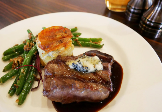 Grilled Grassfed New York Strip Loin with Maytag Blue Cheese Au Gratin Potatoes and Chipotle Coffee Demi-Glace