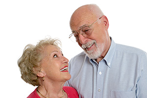 Senior couple enjoying a conversation with help from modern, invisible hearing aids.