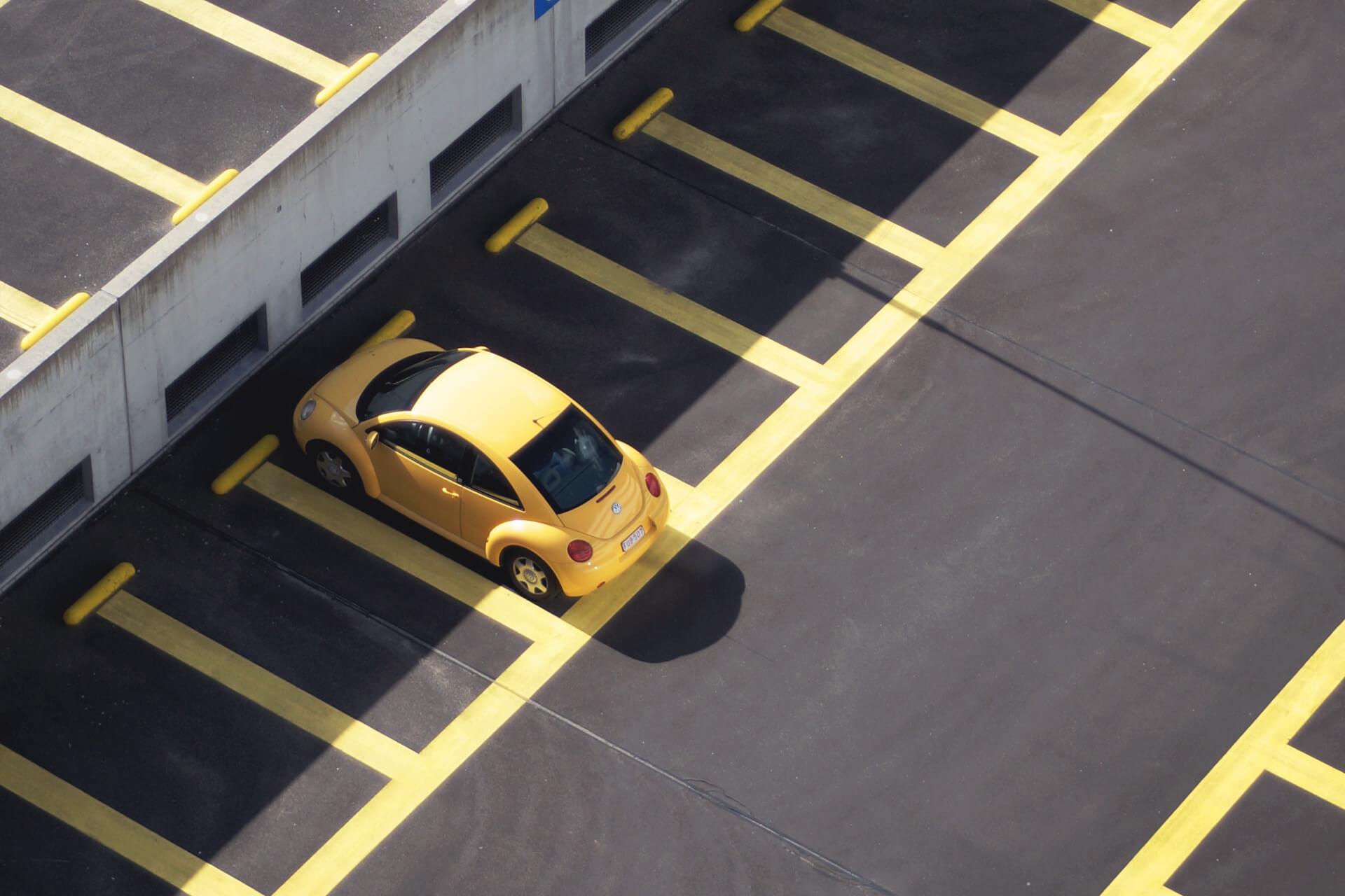 Car Park with Yellow Volkswagen Beetle