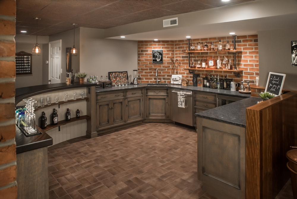 Photo of a basement bar area remodel by Jim Martin Design
