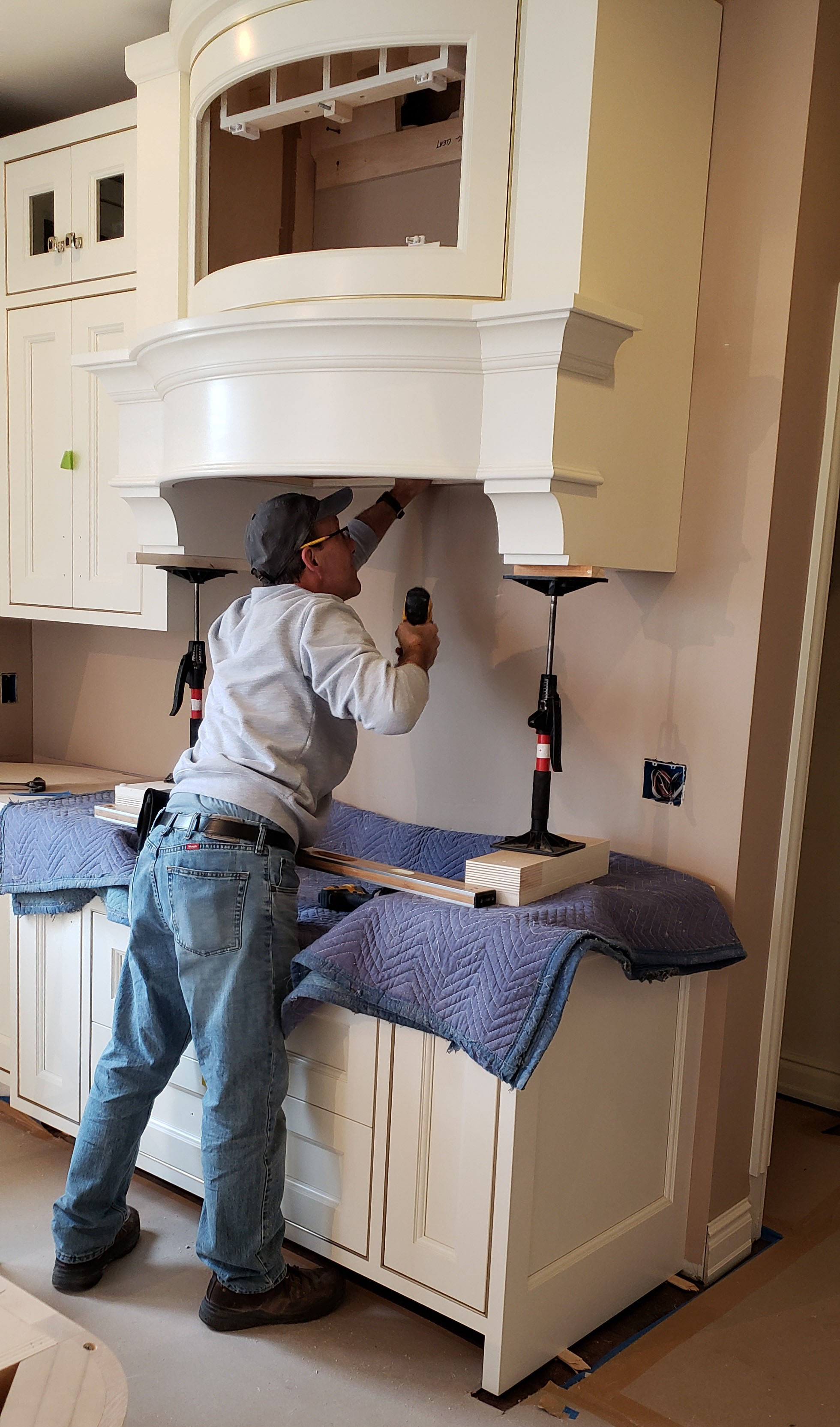 cabinetry installer installing kitchen cabinetry at jim martin design project