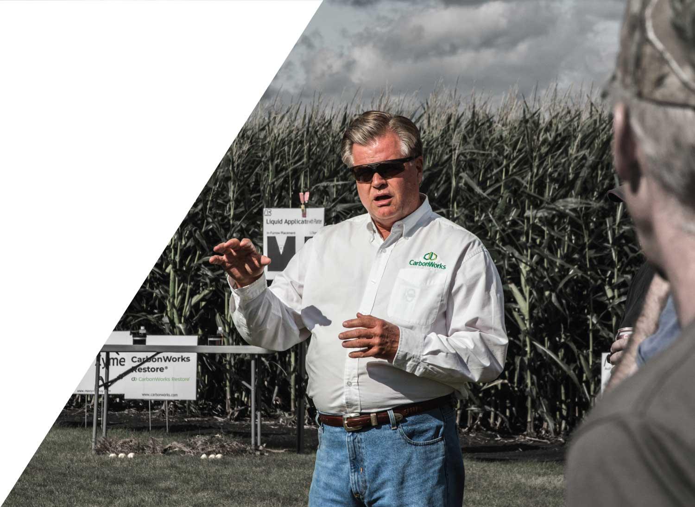 George Sims teaching farmers