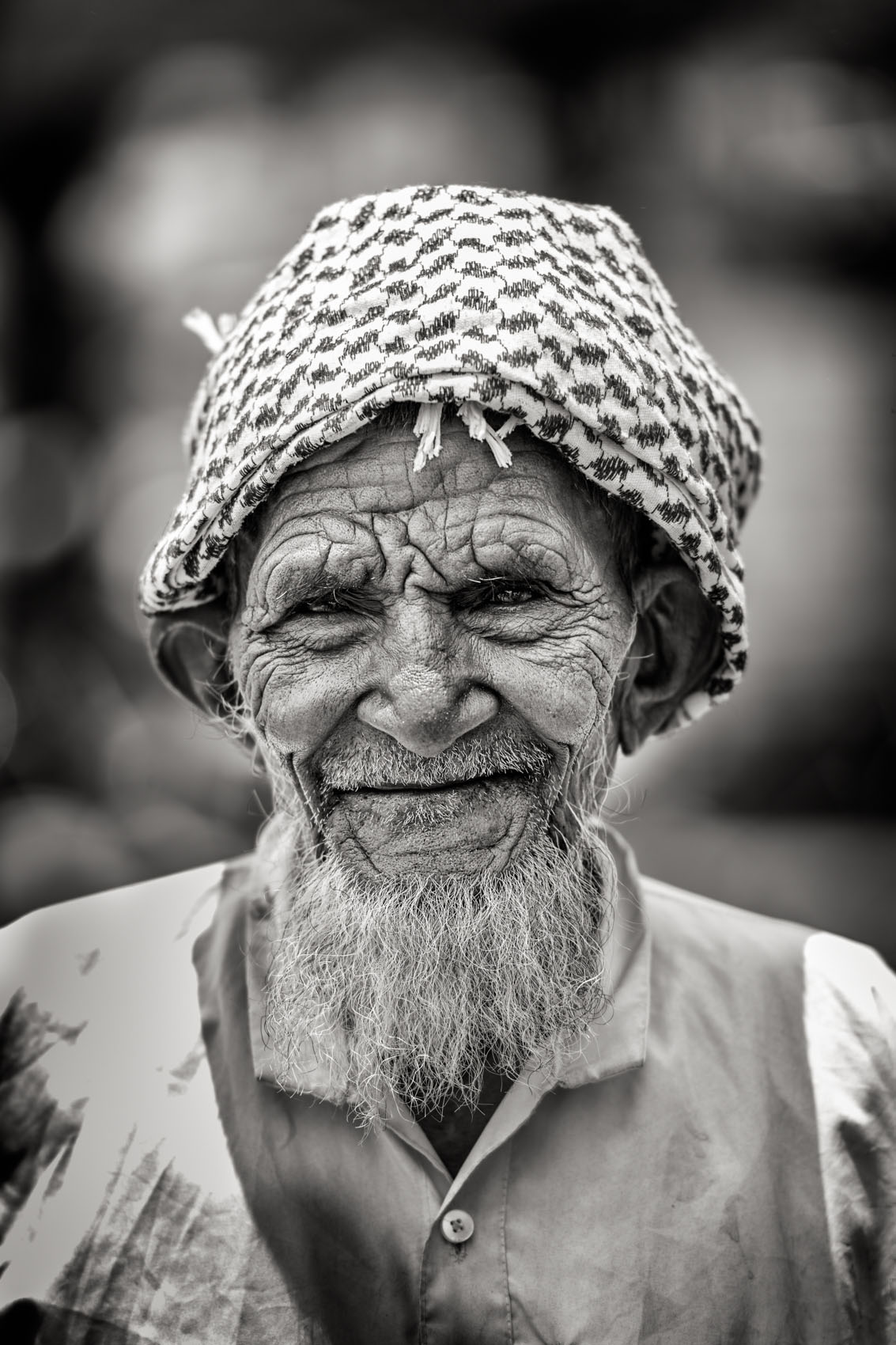 Foto van een man met muts en baard