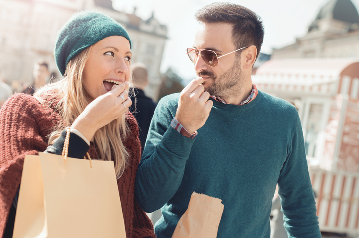 couple having fun eating and shopping