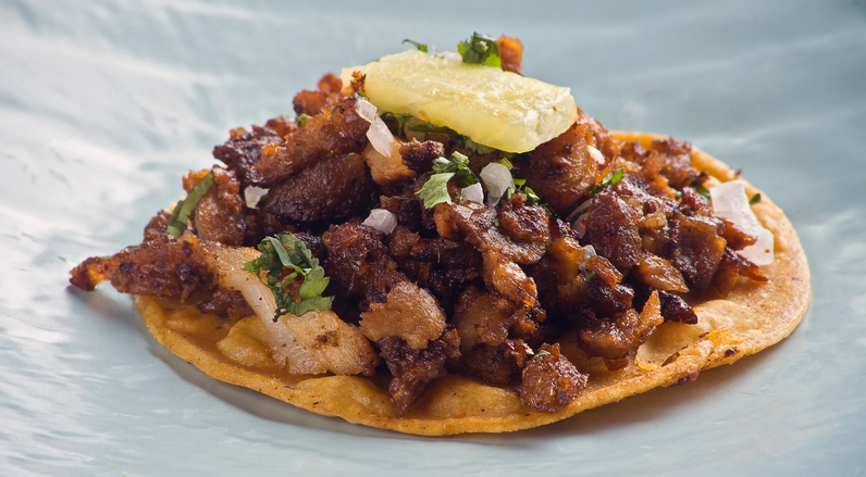 al pastor taco with pineapple on top