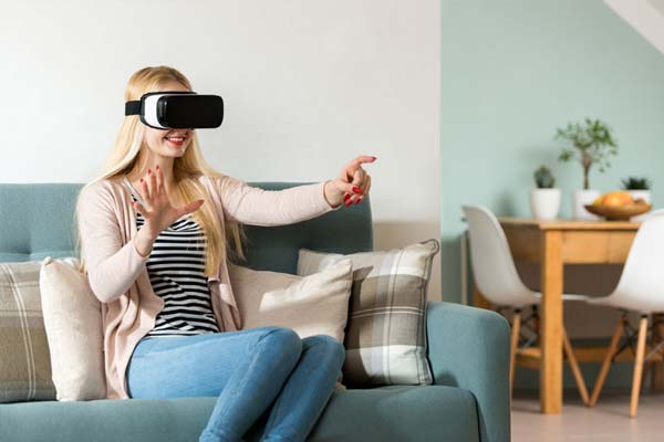 A woman excited to be wearing a VR headset