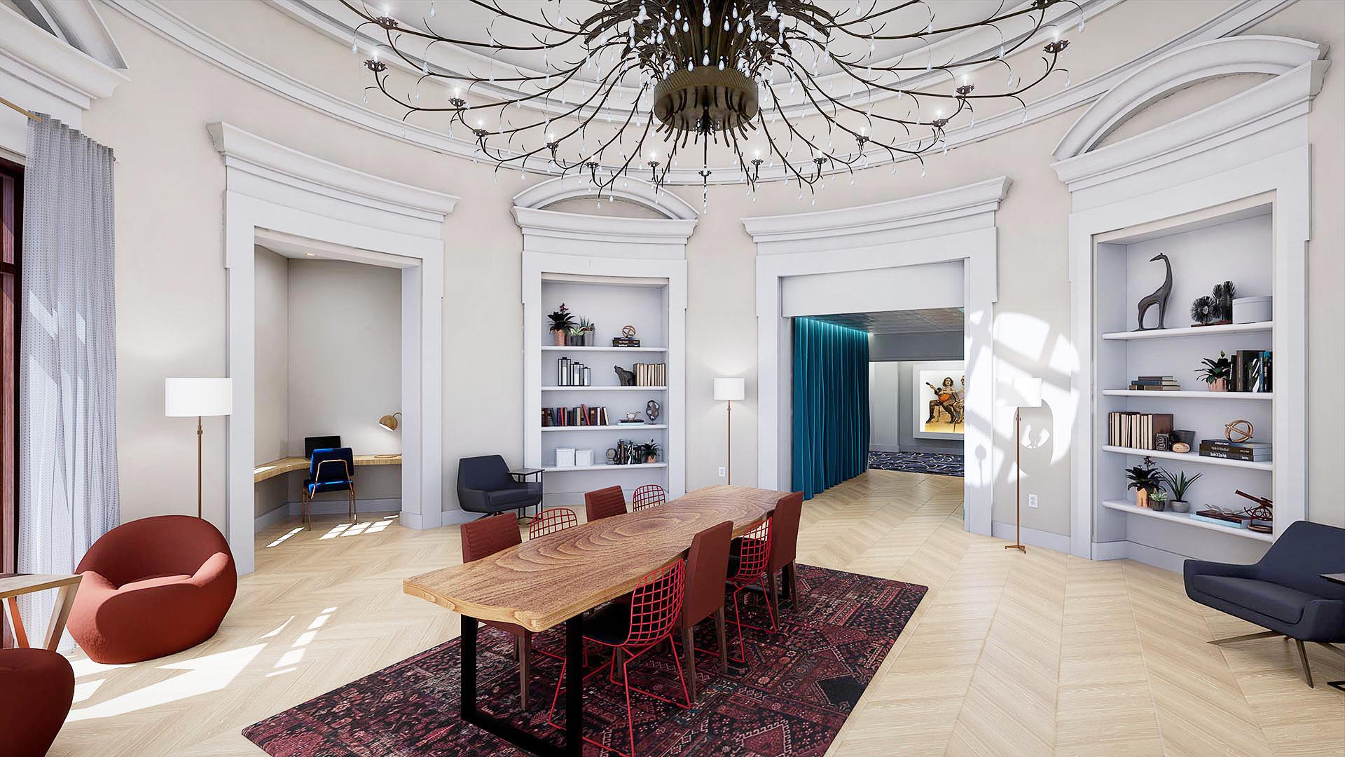An apartment rotunda with built in shelving and chandelier lighting