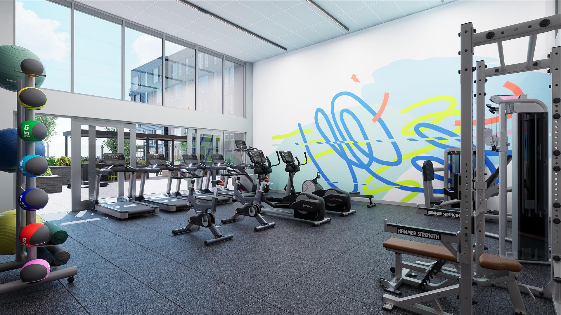 An apartment fitness center with walls opening to outside