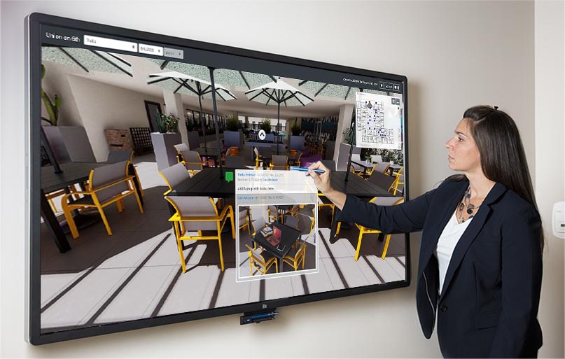 A person with a touchscreen using our Sizzle virtual tour product