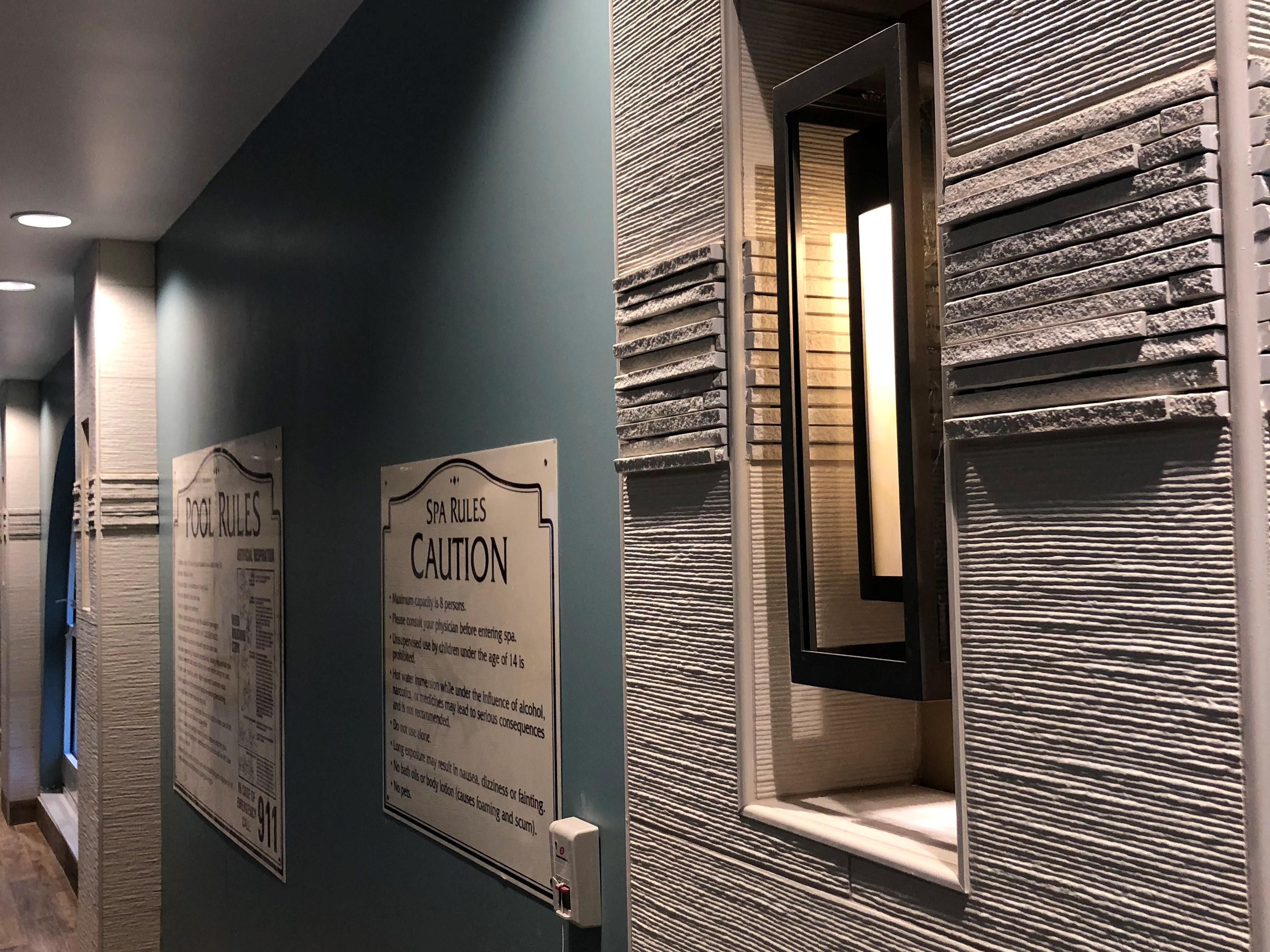 Interior Pool Remodel ceramic tile Mediterranean luxury trespa panels indoor pool senior care The Covington Aliso Viejo