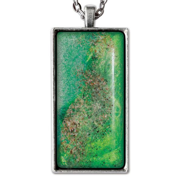 photo of sand necklace pendant with silver tone  backing and chain