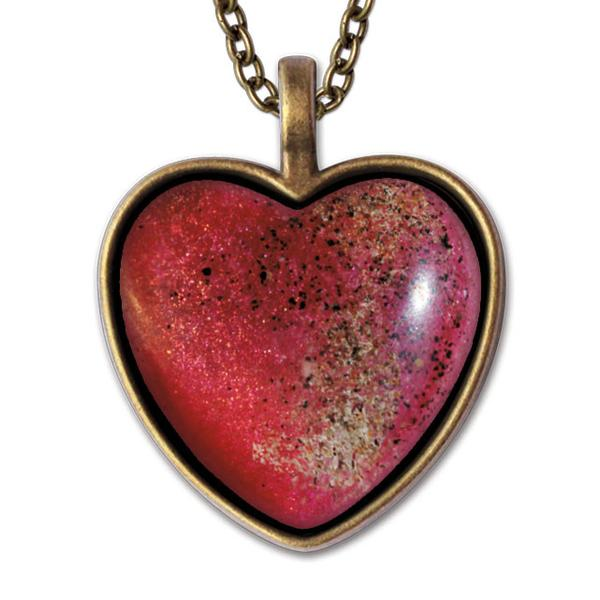photo of sand necklace pendant with bronze backing and chain
