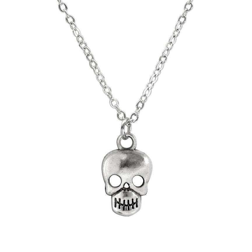 Remember and honor the spirits that have passed on. The silver skull charm necklace shows that death is just another door.