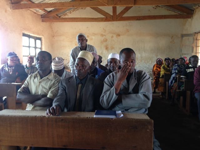 Meeting with the farmers in a Mtae village school classroom. At such meetings, the women remain  observant but, for the most part, silent. We do, however, meet regularly with the women's groups in the absence of the men.