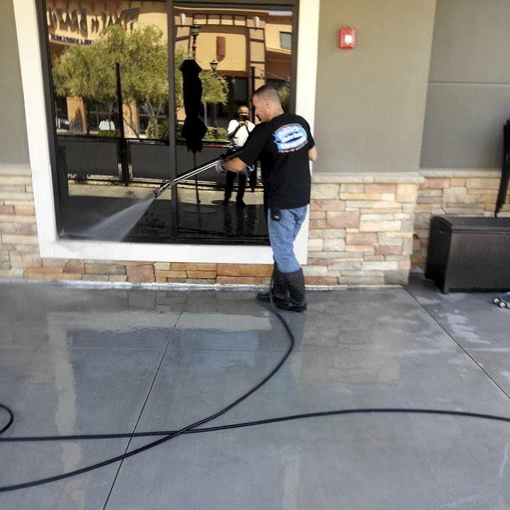 Pressure washing outside a commercial building