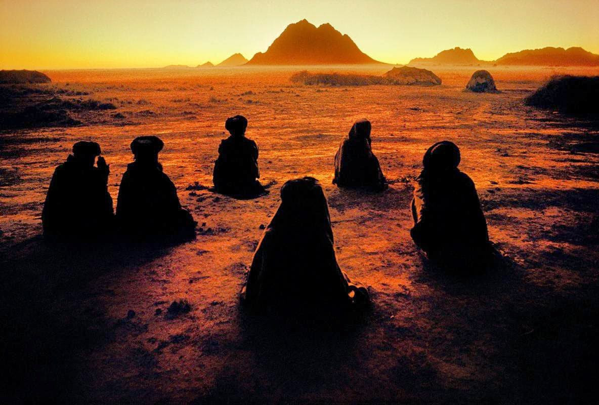 Courtesy, Steve McCurry, Afghanistan, Kuchi Nomads at Prayer, 1992.