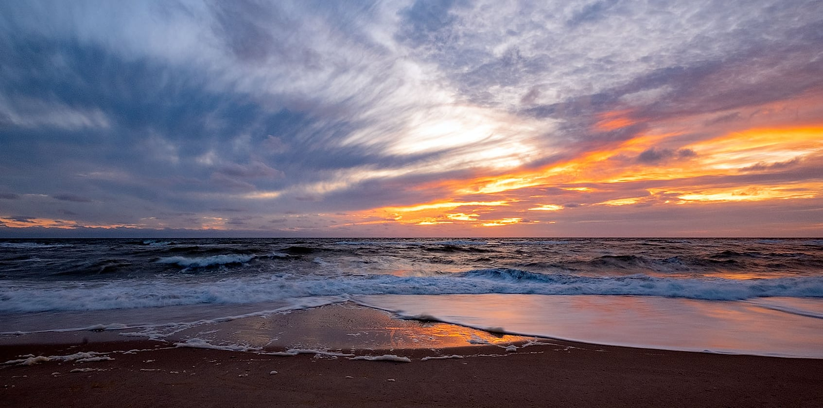 Zee zonsondergang door fotograaf Jan Duker