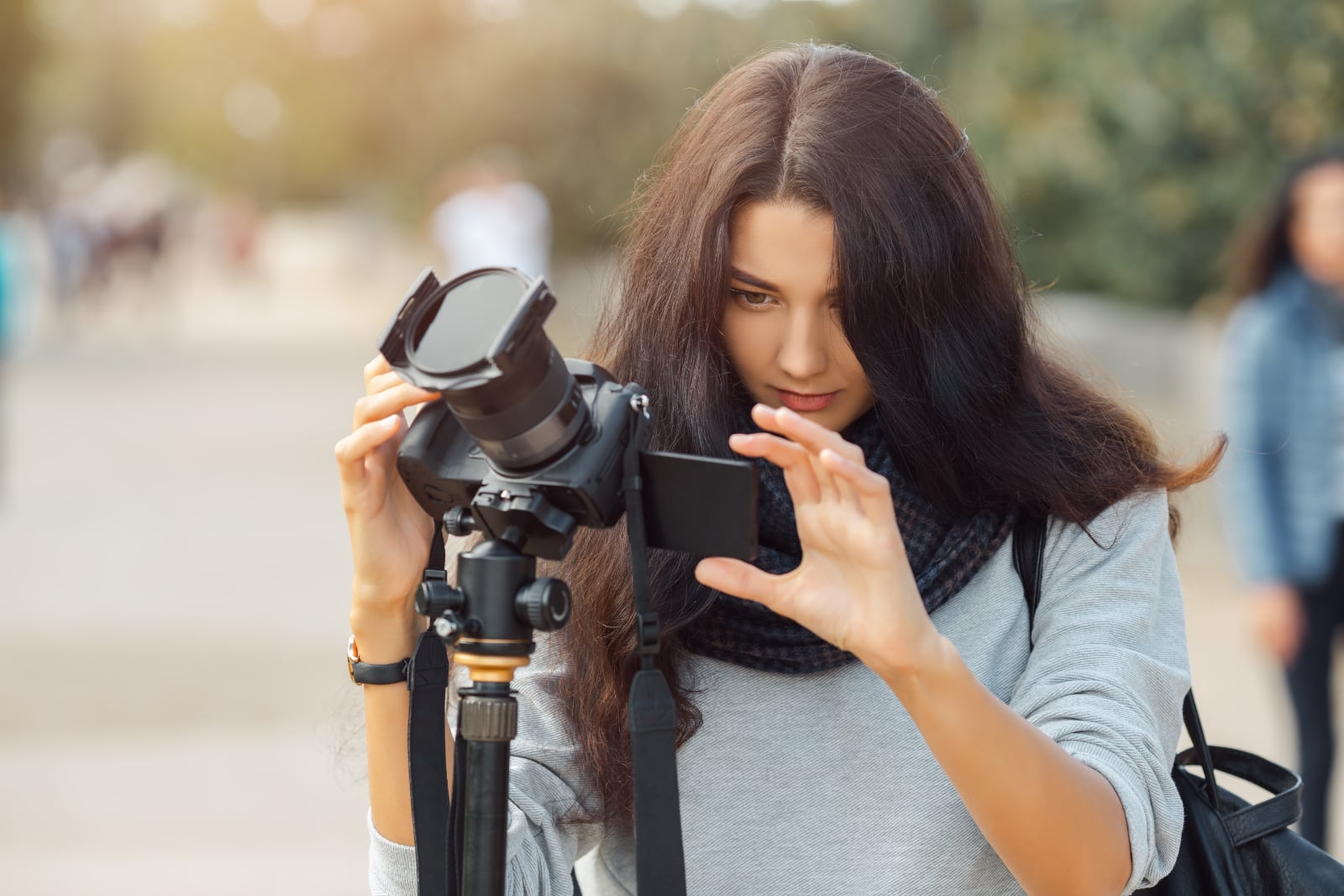 woman-professional-photographer-taking-landscape-images-with-dslr-camera-tripod-outdoors