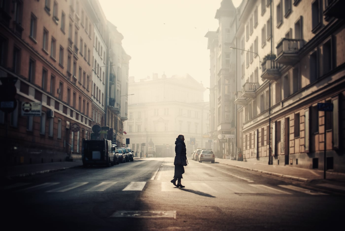 person-middle-streets-poznan-surrounded-by-old-buildings-captured-poland