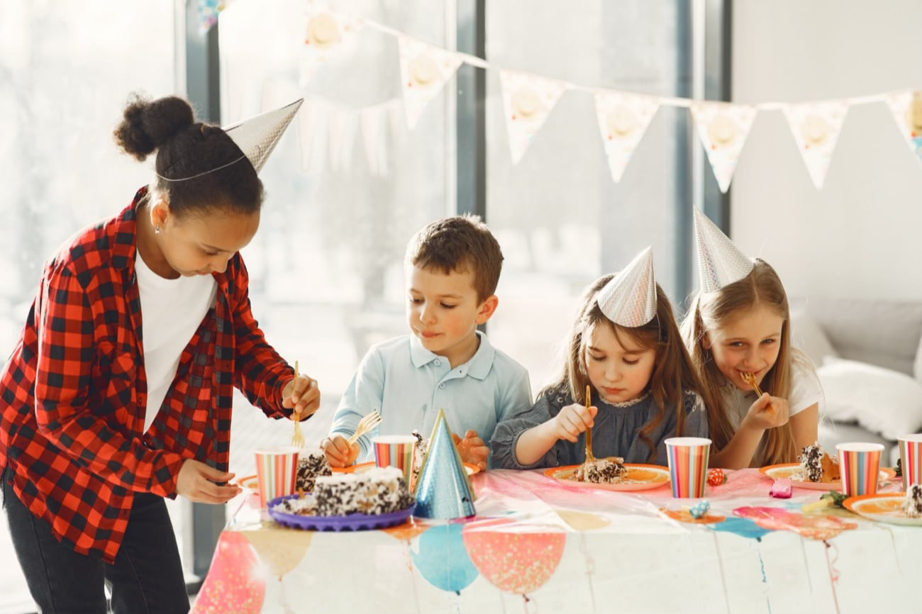 children-s-funny-birthday-party-decorated-room-happy-kids-with-cake-ballons
