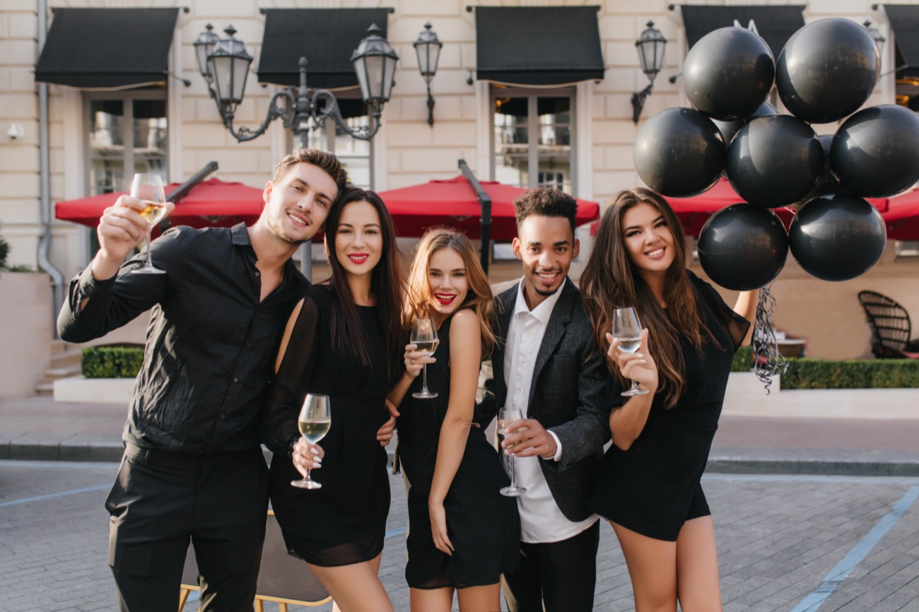 cheerful-friends-drinking-champagne-party-outdoors