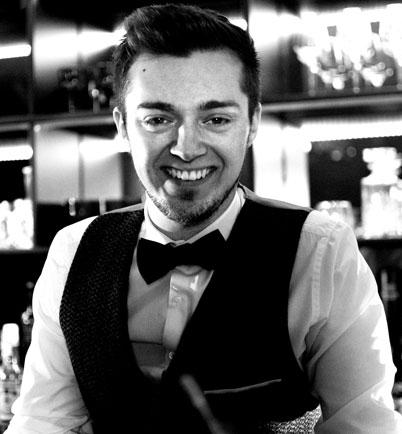 Photo of Daniel Twine in waistcoat & bow tie