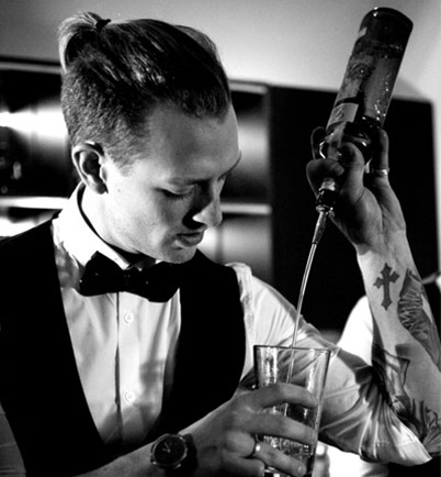 Photo of Alexander Legret in waistcoat & bow tie