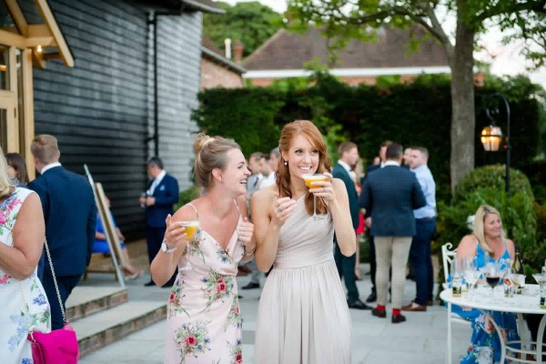 bridesmaids with cocktails in hand
