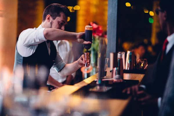 Mixologist making espresso martini