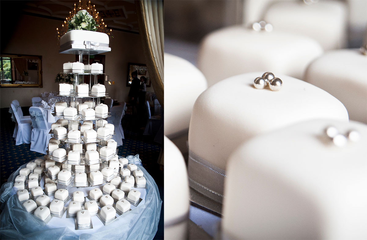 A cake tower with a large square topper for cutting, naked wedding cakes