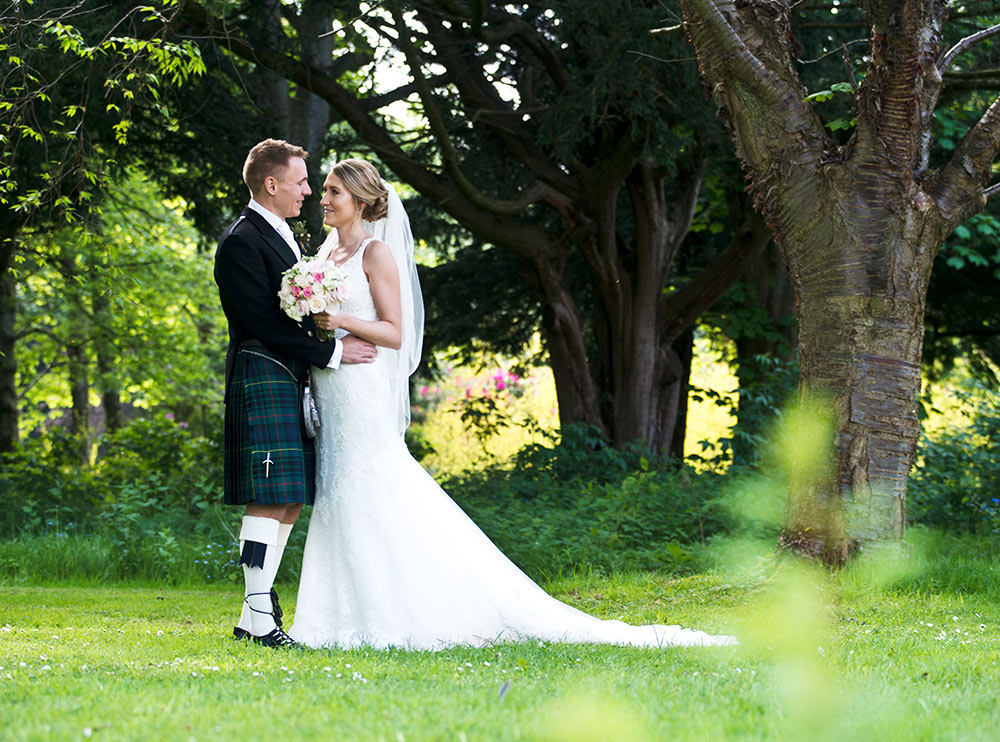 The mature trees give a timeless feel to photographic moments, Carberry Tower Wedding Venue near Edinburgh