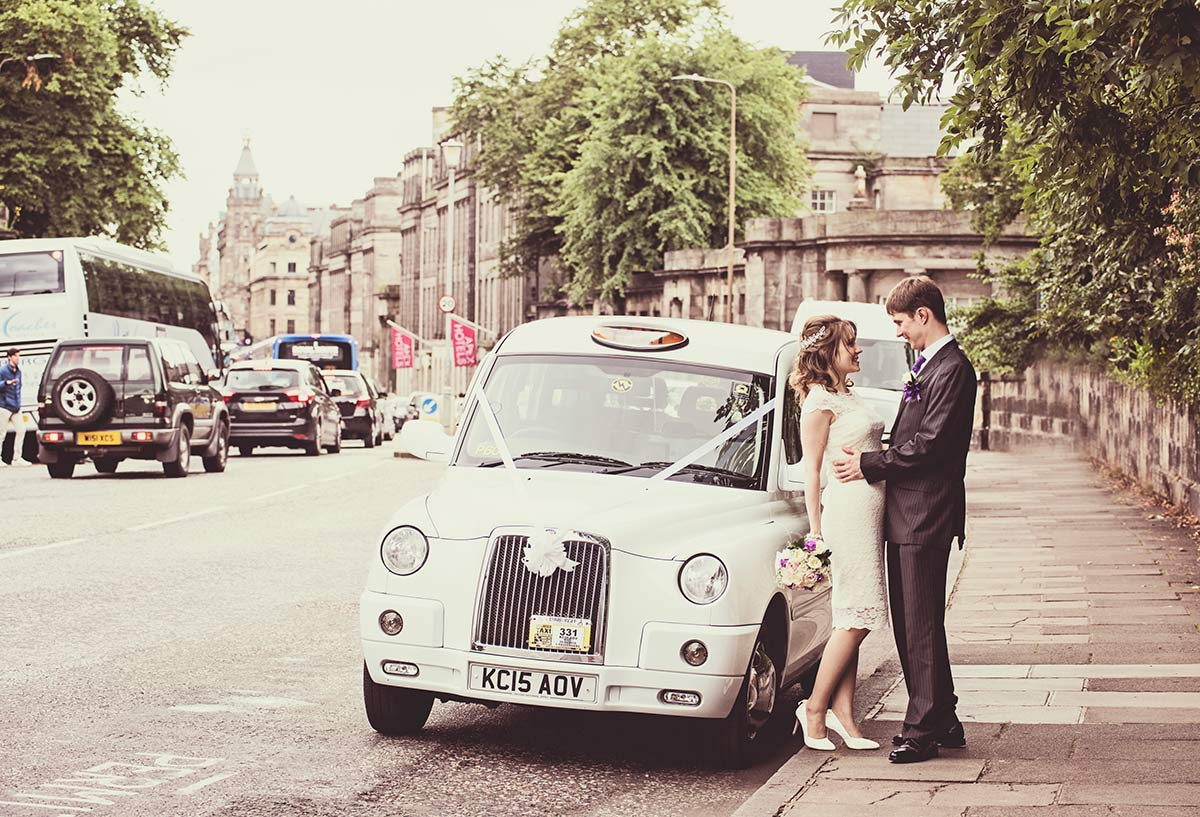 A photograph of the couple with their wedding car, guide to getting married in Edinburgh city centre