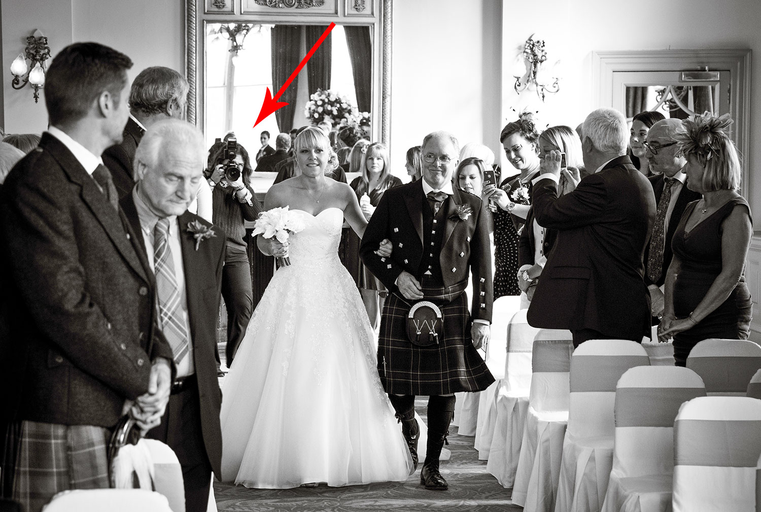 This is me taking photographs from behind the bride walking down the aisle. I also managed to take photographs at the front of the ceremony, as there was lots of room in the wedding ceremony room in the Balmoral Hotel in Edinburgh, best spot for the photographer during the wedding ceremony