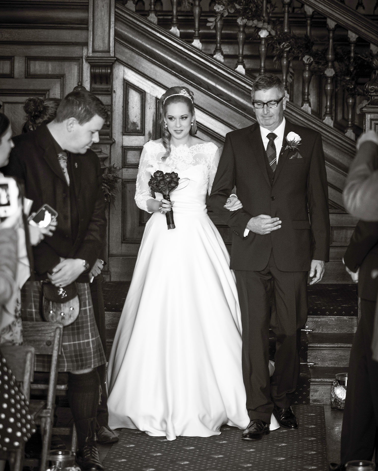 I took this photo with just available / natural light coming in through the big windows at Dalhousie Castle. It's fabulous to see the bride and her dad walking down the aisle, best spot for the photographer during the wedding ceremony