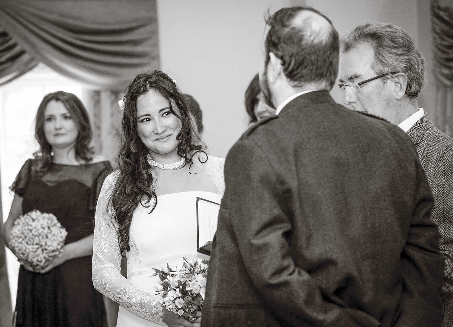 I usually try to position myself opposite the bride. And if I can, at a strategic moment - without drawing attention to myself - I might move across to be opposite the groom for a little while during the ceremony too, best spot for the photographer during the wedding ceremony