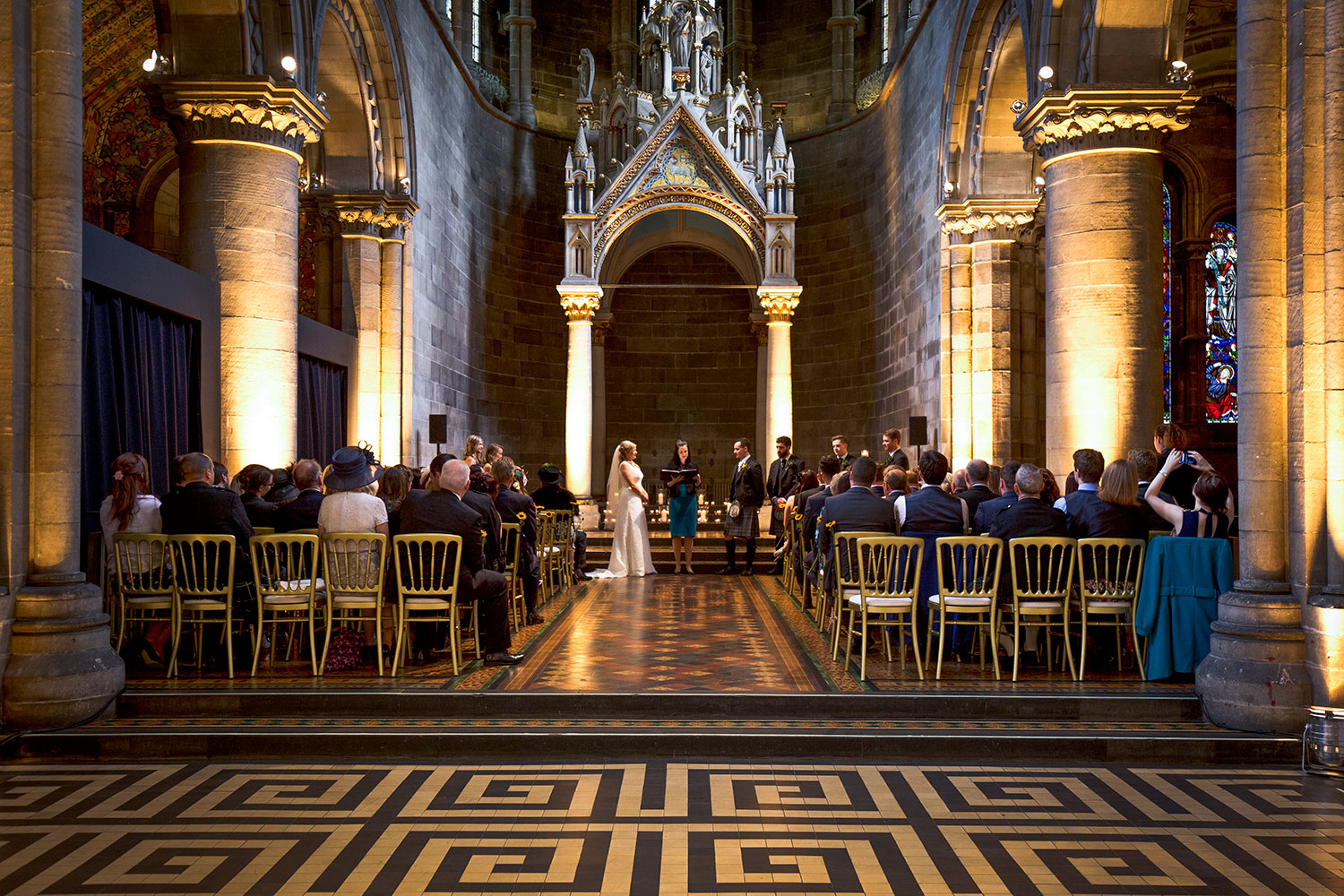 As the room is so big, I could easily slip off to the side and then make my way behind the congregation to take photographs of the big room in all its beauty, best spot for the photographer during the wedding ceremony