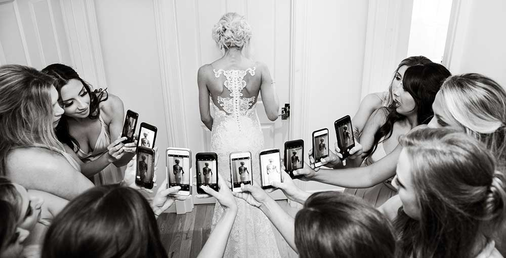 The girls taking photos of the bride, bridal survival kit