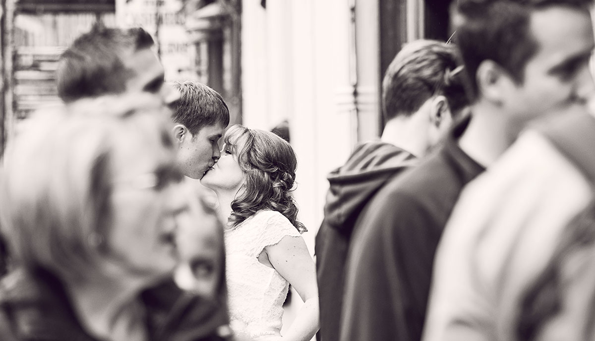 A photograph of the couple, looking through the crowds, guide to getting married in Edinburgh city centre