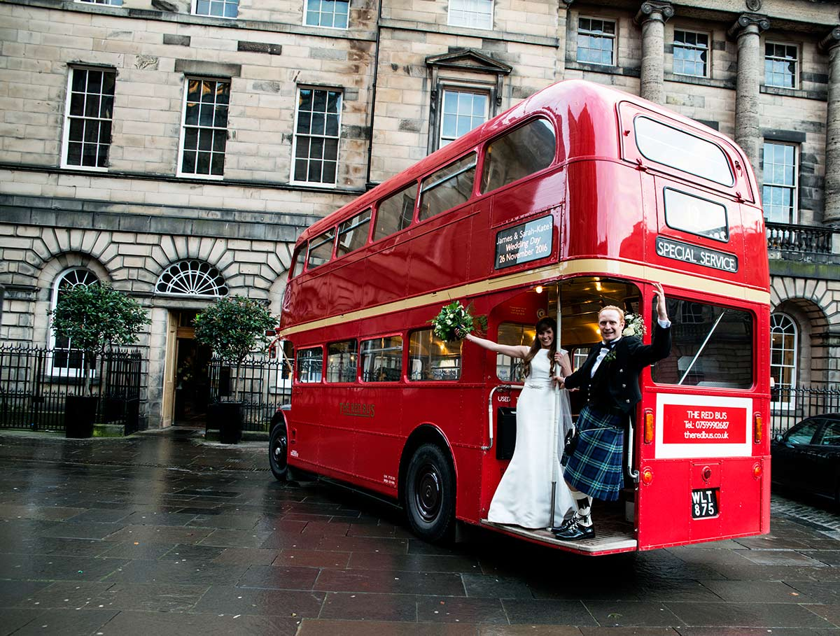 A photograph of the couple with their wedding bus, guide to getting married in Edinburgh city centre