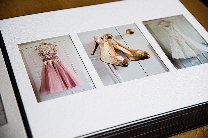 As you can see in the image, the photographs are behind the white matt. This looks very elegant and classy, wedding album styles