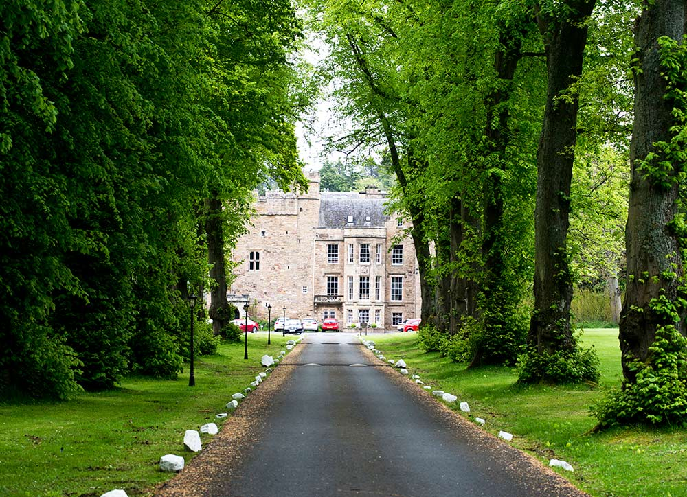 The ancient trees provide a majestic avenue to Carberry Tower, Carberry Tower Wedding Venue near Edinburgh