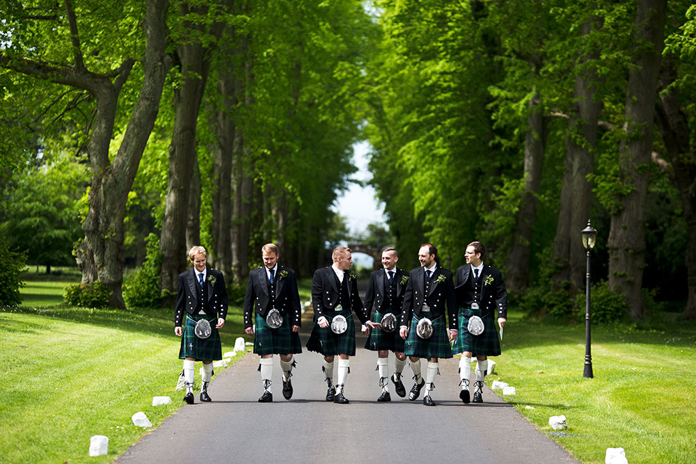 The other angle of the avenue gives ideal framing to group shots, Carberry Tower Wedding Venue near Edinburgh