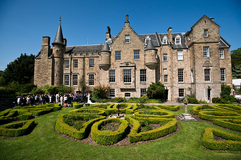 The knot-work formal gardens provide a distinct setting, Carberry Tower Wedding Venue near Edinburgh