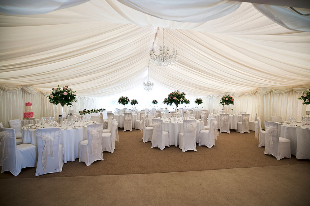 A sumptuous marquee provides a soft and gentle space, Carberry Tower Wedding Venue near Edinburgh