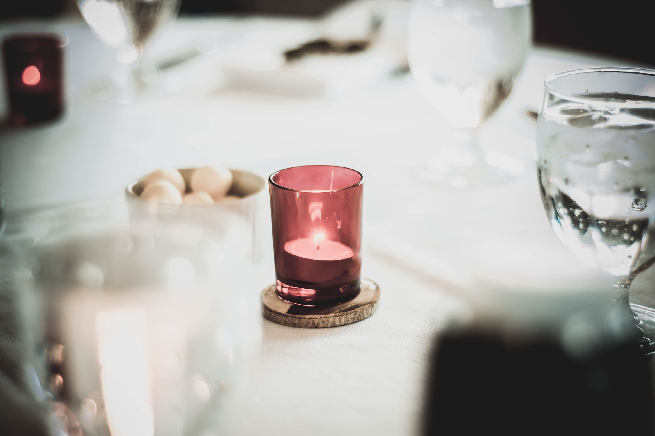 red tinted candle on table