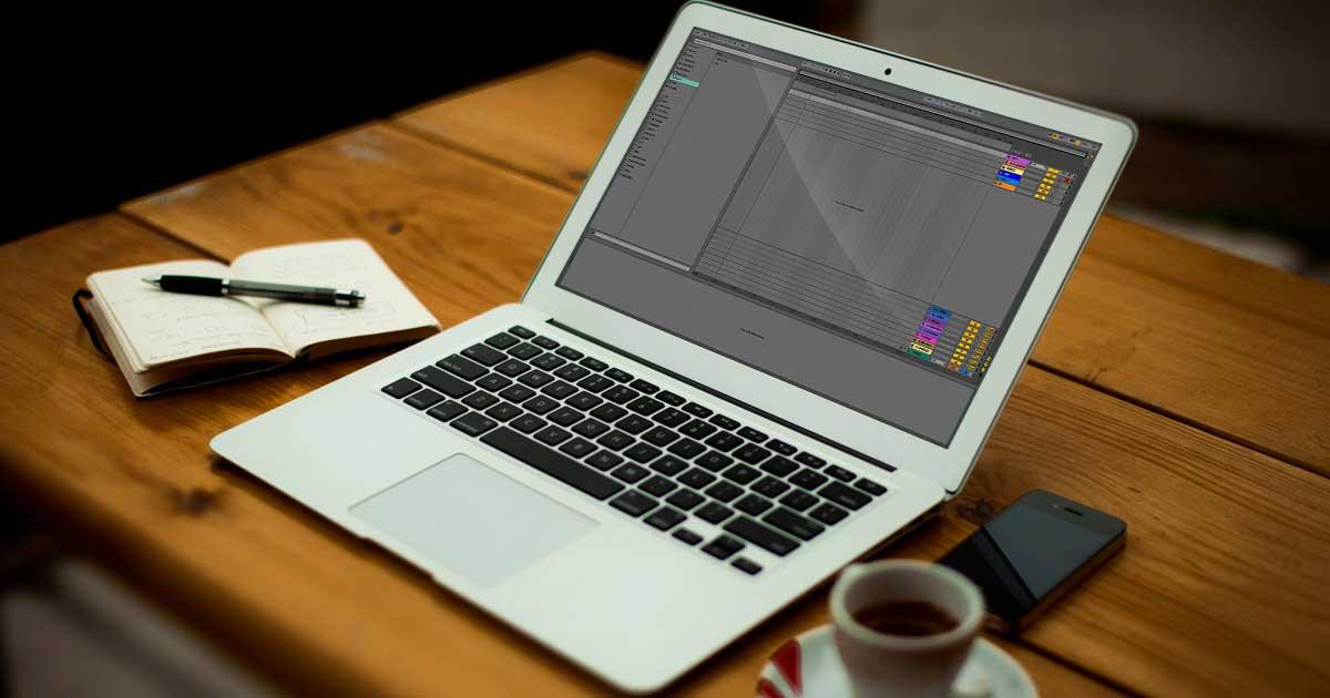 A MacBook sitting on a desk.