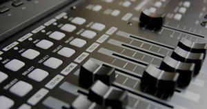 Mixing console track faders.