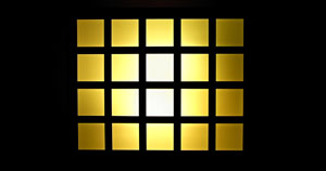 A yellow square divided by a black grid.