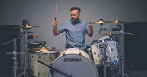 A man playing a drum kit.